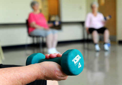 A Chair Exercise can be done with or without dumbbells